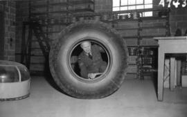 [Airman looking at airplane tire in the R.C.A.F. equipment depot #2]