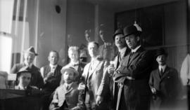 [Group of men drinking beer]