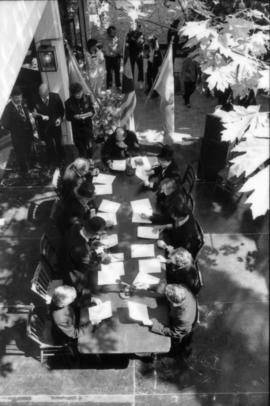 View from above of actors seated at table