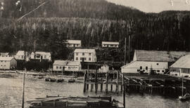 Arrandale cannery and buildings along wharf with floating dock and boats
