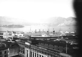 "[View of C.P.R. docks with C.P.R. station in foreground, ""Empress"" liner and ""Aora..."