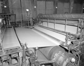 [Man operating a] paper machine [at] Pacific Mills