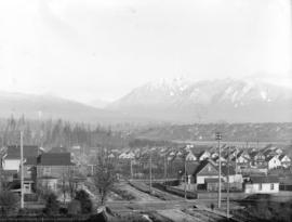 [View of Kitsilano area, West End, and North Shore mountains, from Seventh Avenue and Pine Street]