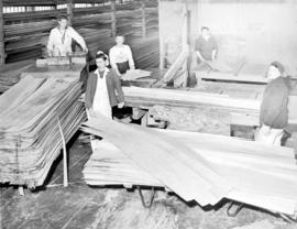 [Women at work in plywood plant]