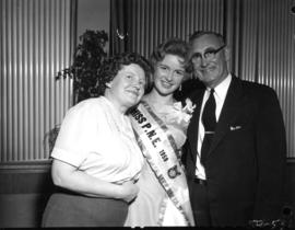 Anna Finlayson poses with man and woman, likely her parents, after being named Miss P.N.E. 1959