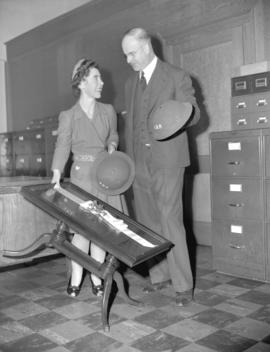 [Presentation of a coffee table to] Ruth Challenger at A.R.P. office