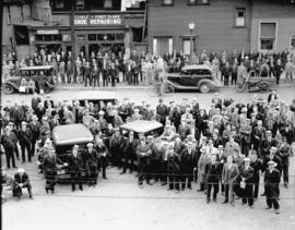 [Crowd gathered on street at Hotel Abbotsford for radio broadcast (?) results of baseball game St...