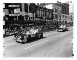 B.C. Lions players J. Jankans, R. Baker, and E. Vereb in car during 1956 P.N.E. Opening Day Parade