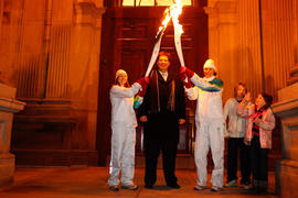 Day 27 Torchbearer 150 Sarah Fitzpatrick passing the flame to Torchbearer 151 Marianne Limpert in...