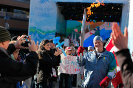 Torchbearer 27 Mark Bunsko carries the flame in Whistler, BC