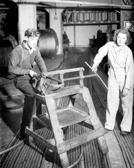 [Woman and man making steel cables]