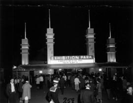 Night shot of crowd at main entrance gate to Exhibition Park