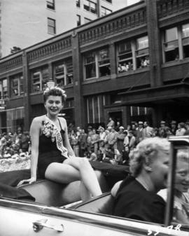 Car carrying Miss Rosebud in 1953 P.N.E. Opening Day Parade