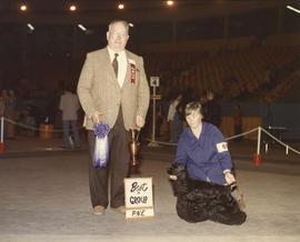 Best in Group [Sporting Group: Cocker Spaniel] award being presented at 1976 P.N.E. All-Breed Dog...