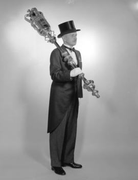 [Full length portrait of Peter Heath, Sergeant-at-Arms, holding the City's ceremonial mace]