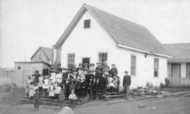 [The students and teacher in front of Hastings Sawmill School]