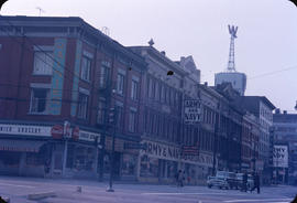 "View of Army and Navy at 36 West Cordova Street and Woodward's ""W"" sign"