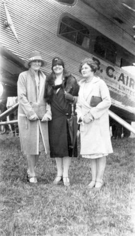 "[Mrs. Ashthorpe, Miss McLeod and friend in front of a B.C. Airways Ltd. ""Ford Transport&quot..."