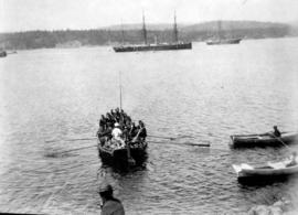 "[""C"" Battery of Royal Canadian Artillery in rowboat approaching the H.M.S. ""Caroli..."