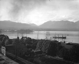 [View of waterfront, Vancouver harbour, ships, and North Shore mountains from the roof of the Mac...
