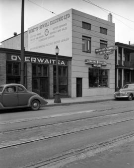 [Exterior view of Ricketts-Sewell Electric Ltd. and Overwaitea in the 1100 block Richards Street]