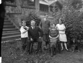 Mr. Pooley and family [in front of house in Dollarton]