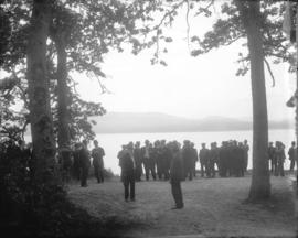 [Men gathered under trees for opening of Saanich Interurban Railway]