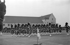 Seaforth Highlanders marching with flags at the opening of the Seaforth Armoury