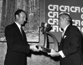 Helmut Bender, B.C. Coast Lumber Grading Champion receives award from R.G. Rogers, Chairman Counc...