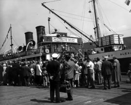 "[People waiting to board the S.S. ""Lady Alexandra"" to see a performance of ""Show B..."