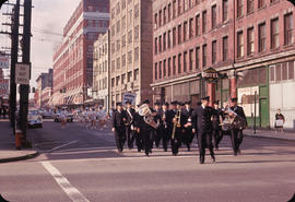 [Parade down 100-Block Water Street - Winters Hotel visible]