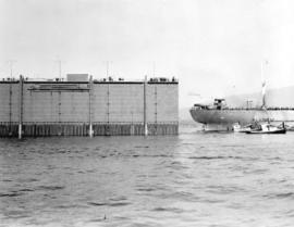[A drydock being moved into position at North Van Ship Repairs (Pacific Drydock) Limited]