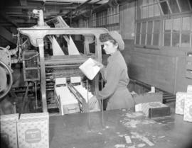 [Woman packaging paper napkins at Westminster Paper]