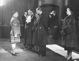 "[Sergeant Ernest A. ""Smoky"" Smith greets H.R.H. Princess Elizabeth and H.R.H. Philip Du..."