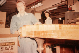 Brown sugar packing line with two female staff members