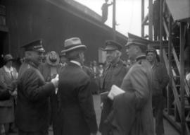 "Group of men, some wearing hats with the words ""Salvation Army"""
