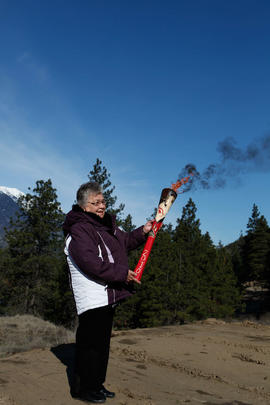 Woman holding torch in Lytton, BC [1 of 3]