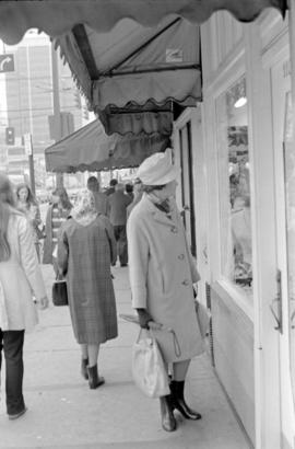 Woman at shop window on Robson Street