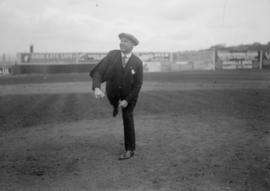 Man standing on one leg in a stadium