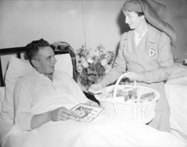 Red Cross nurse [handing out cigarettes at] Shaughnessy Hospital