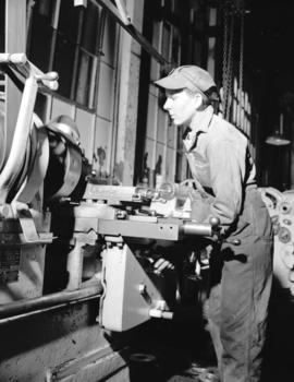 Burrard Shipyard - Miss Stella Becker [working a] lathe