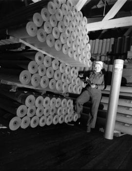 [Woman checking paper] rolls [at] Pacific Mills