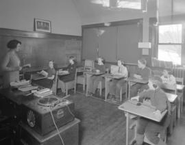 [Students and teachers in language lab at] School for Deaf and Blind [4100 West 4th Avenue]