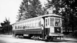 [Man with #7 Fraser streetcar]
