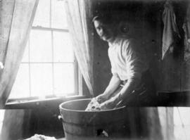 [Robert Jamieson doing laundry, Good Hope Cannery, Rivers Inlet]