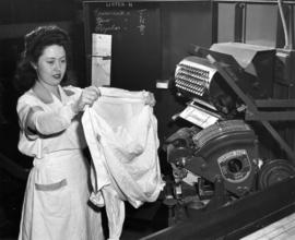 Nelson's staff person demonstrating shirt pressing on a Fantom-Fast machine