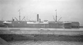 [Freight ship at dock]