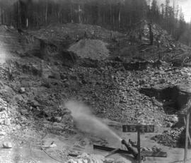 Coquitlam Dam [showing] hydraulic monitor sluicing material