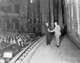 [Mayor L.D. Taylor congratulates Percy Williams on the stage of the Vancouver Opera House]