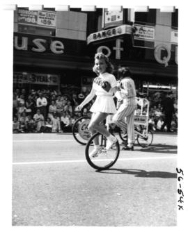 Girl on unicycle in 1956 P.N.E. Opening Day Parade